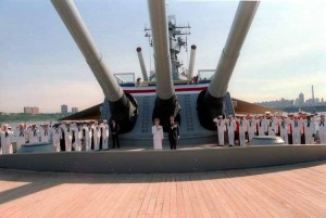 President and Nancy Reagan standing under the guns of the battleship U.S.S. Iowa during the Statue of Liberty Centennial weekend celebrations. 7-4-86