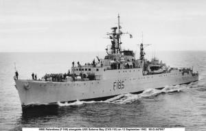 HMS Relentless (F 185) alongside USS Salerno Bay (CVS-110) 13 Sep 1952