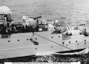 HMS Relentless (F 185) alongside USS Salerno Bay (CVS-110) 13 Sep 1952 - transfer
