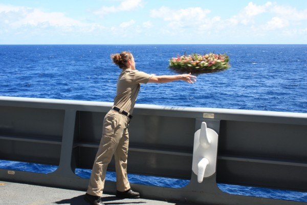 Melissa Stark second mate navigator on USNS Amelia Earhart tosses a memorial wreath into the Pacific Ocean off Howland Island U.S. Navy photo by Capt. John Pope