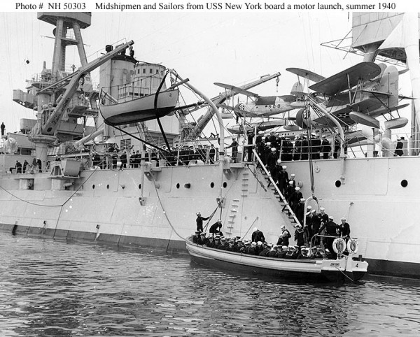 Midshipmen and Sailors boarding a 50-foot motor launch, during the summer 1940 Naval Academy Midshipmen's cruise