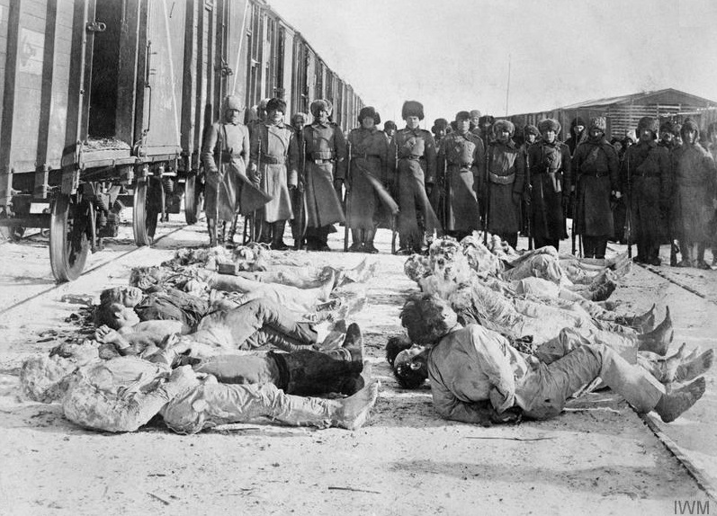 Frozen bodies of White Russian soldiers, massacred by Bolsheviks and recovered by British troops from under the snow. Over 4000 of them were mutilated and tortured to death Omsk, winter 1919.