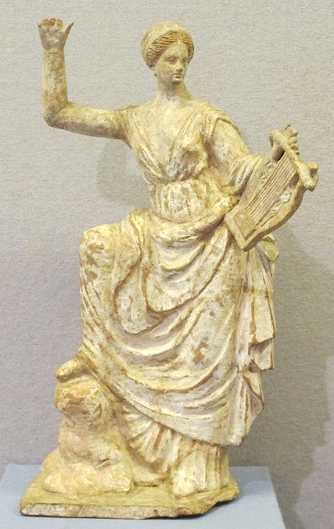 485px-Terracotta_da_tanagra,_musa_con_la_cetra,_250-200_ac.