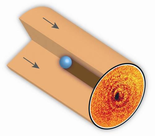 Фактически, на снимке виден силуэт, тень атома