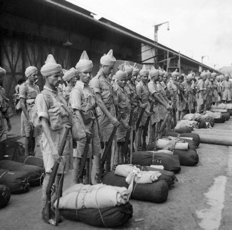 Newly arrived Indian troops parade on the quayside at Singapore - November 1941