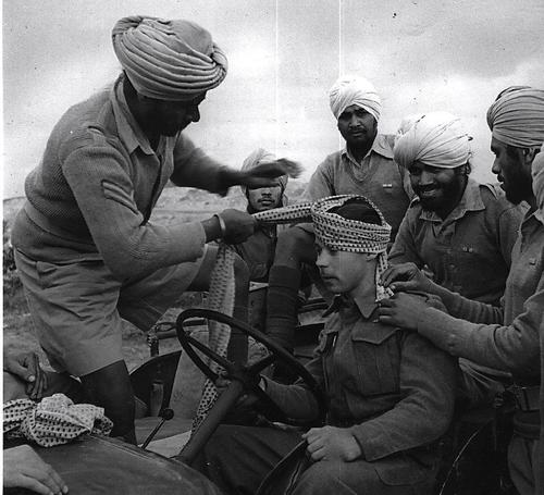 Sikh turban-tying lessons on a British Soldier in WWII