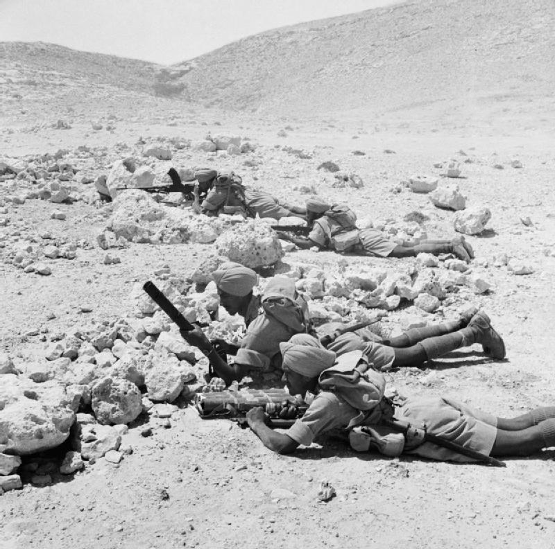 Sikh_troops_armed_with_Bren_guns_and_a_2-inch_mortar,_training_in_the_Western_Desert,_6_August_1941._E4667