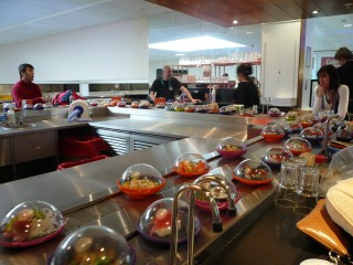 Fascinated by a conveyor belt of sushi during our four hour delay in the Gatwick airport