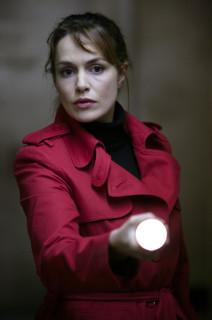 Claudia with torch - season 1 promo