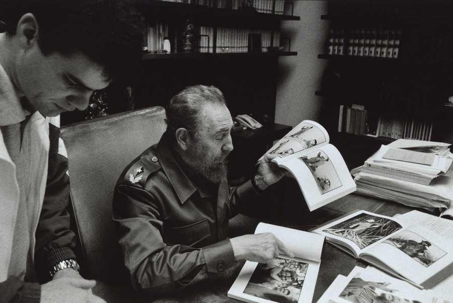 16 Burt Glinn CUBA. CASTRO, Fidel, 2001. Castro in his office in Havana looking at photographs from th.jpg