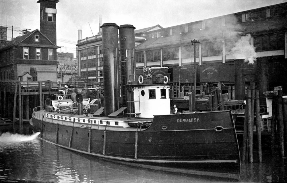 The nearly new fireboat Duwamish (1909) holds to her Firehouse No. 5 at the foot of Madison Street, circa 1912. (courtesy Lawton Gowey)