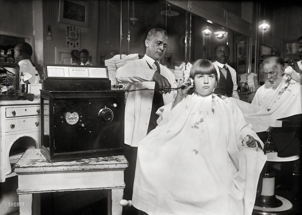 Washington, D.C., circa 1922. Coin-operated radio in barbershop