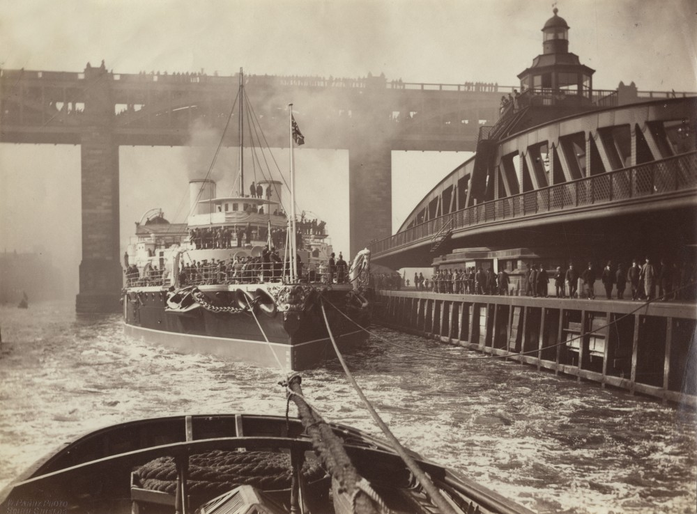 HMS Victoria passing a swing bridge while en route from Armstrong Shipyard at Elswick, Newcastle-upon-Tyne, circa 1890