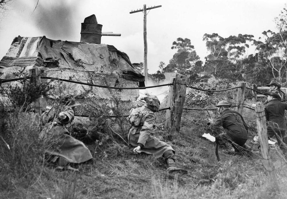 Volunteer Defence Corps members ambushing a tank [ca. 1942]