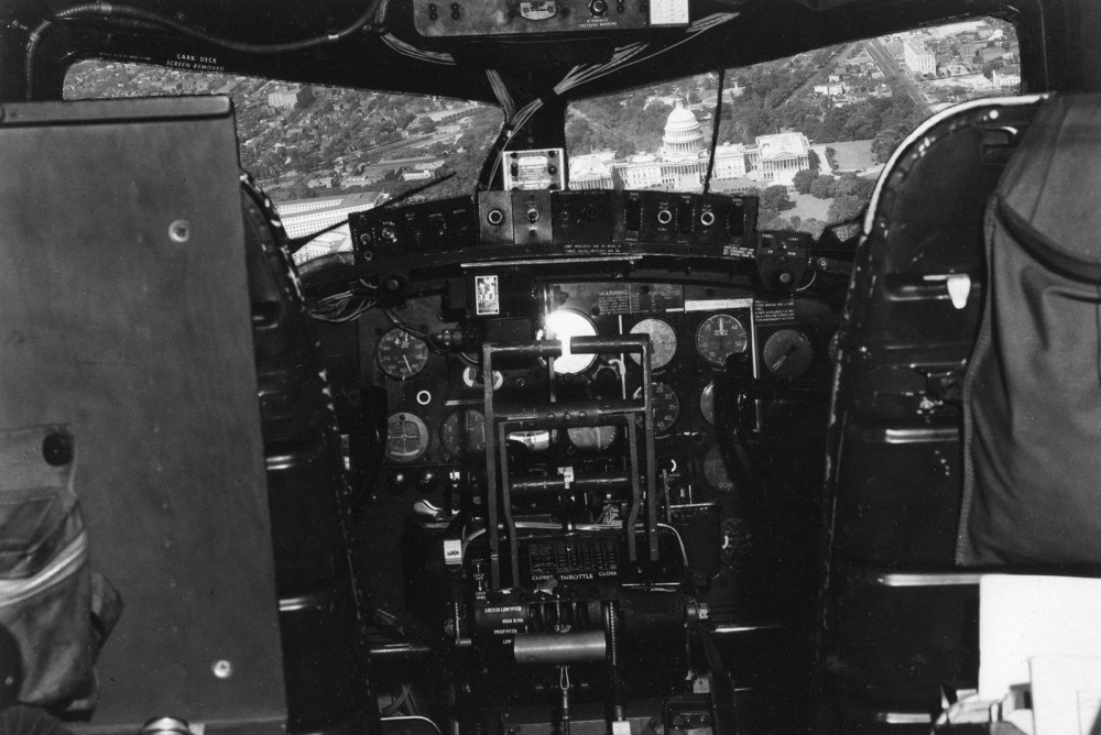 The unmanned cockpit of a Boeing B-17 drone making a diving pass on the U.S. Capital Building in Washington D.C.