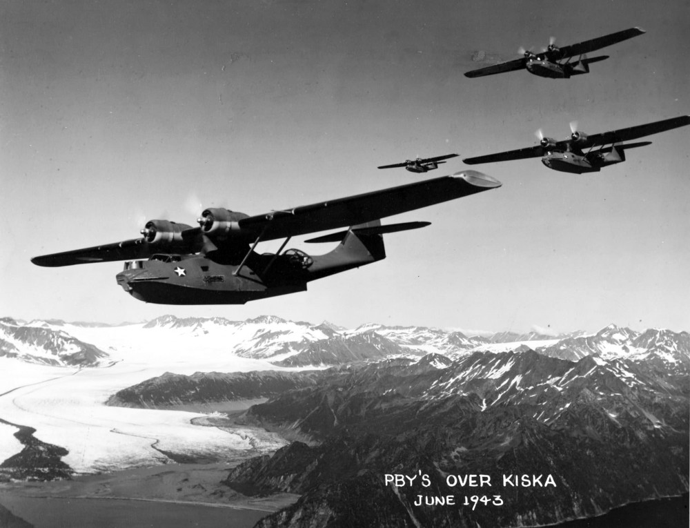 PBY Catalinas flying over Kiska, Aleutian Islands in June 1943. From the Vice Admiral Robert C. Giffen Photo Collection S-487.06
