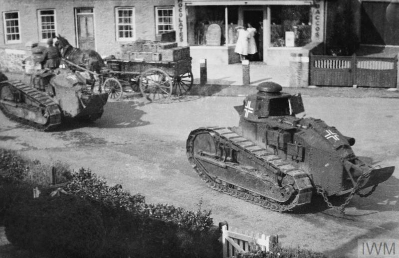 Guernsey. It shows captured French Renault FT17 tanks pressed into service by the Germans moving along La Rue Cauchee in St Martin's, after the German occupation of the islands in 1940