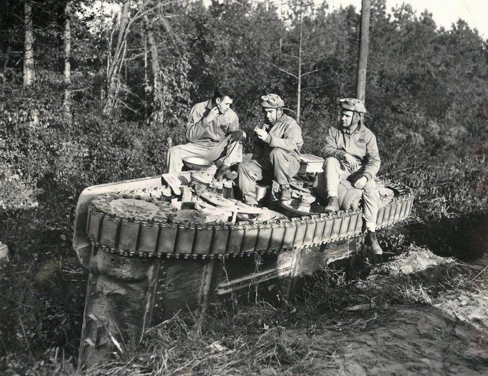 2nd AD tankers on an overturned M3 Stuart Light Tank during Maneuvers