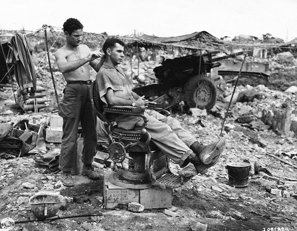 US Marine getting a Hair Cut on Okinawa, 1945
