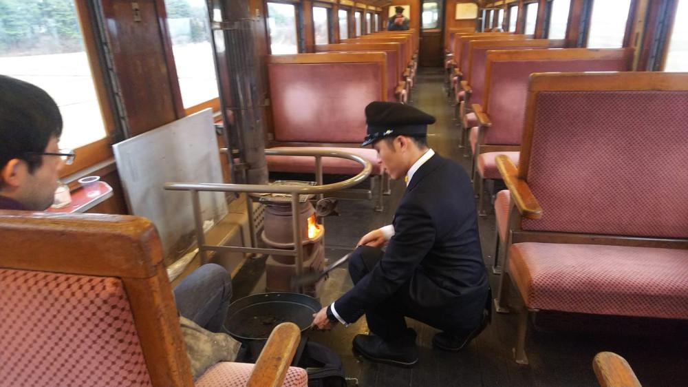 New conductor, doing the fire stove preparation for Tsugaru railway's stove train