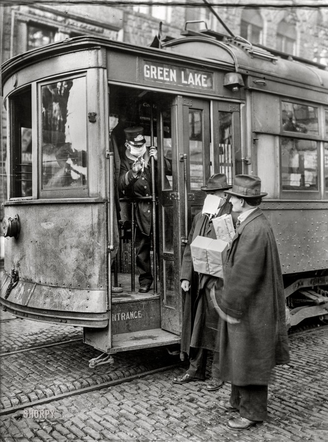 Ca. 1918-1919. Precautions taken in Seattle, Wash., during the Spanish Influenza Epidemic would not permit anyone to ride on the street cars without wearing a mask