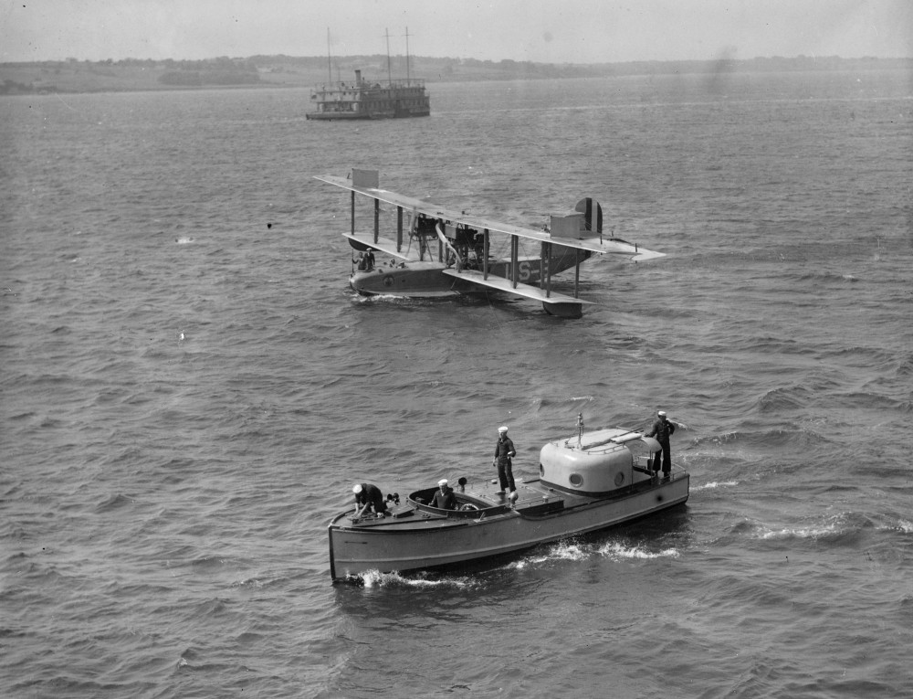 Seaplane in water floats nearby [ca. 1917-1934]