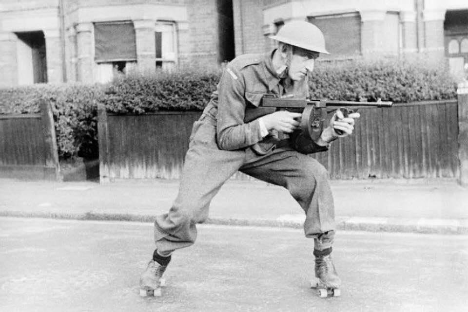A Home Guard `on wheels` attacking one of the enemy with a Tommy gun