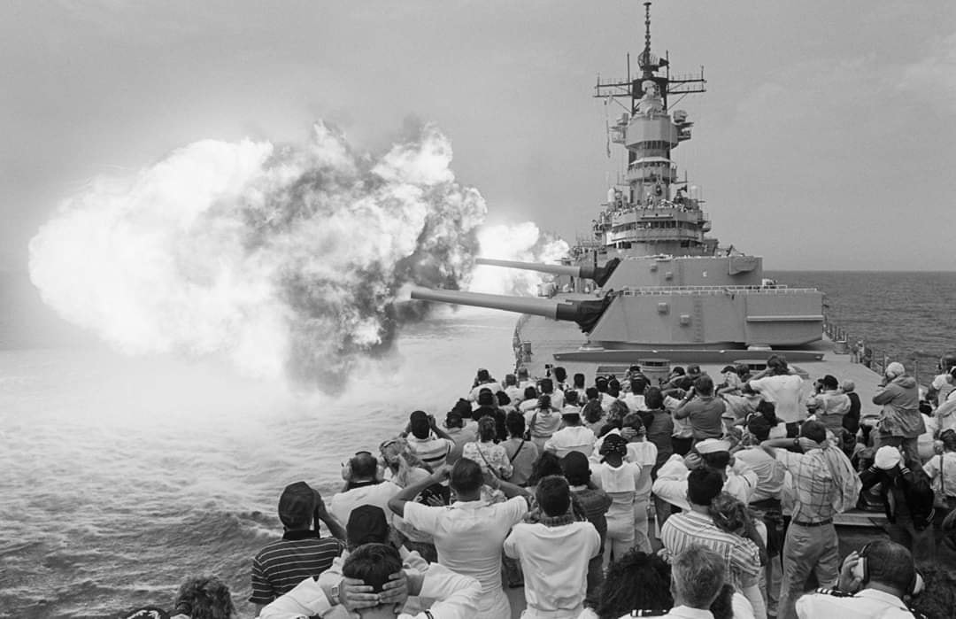 Guests attending a Dependents Day Cruise aboard the battleship USS MISSOURI (BB 63) as the ship fires its Mark 7 16-inch guns during a firepower demonstration, 24.8.1988