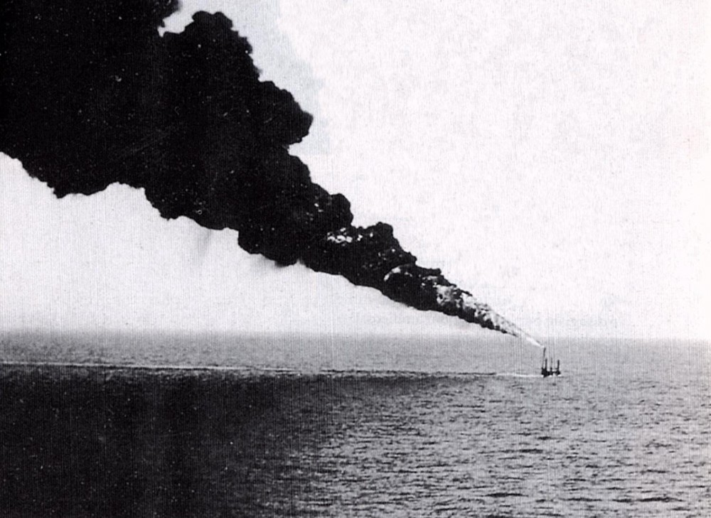 The photo depicts the Italian mameli class submarine Tito Speri testing out her Girosi flamethrower in 1938