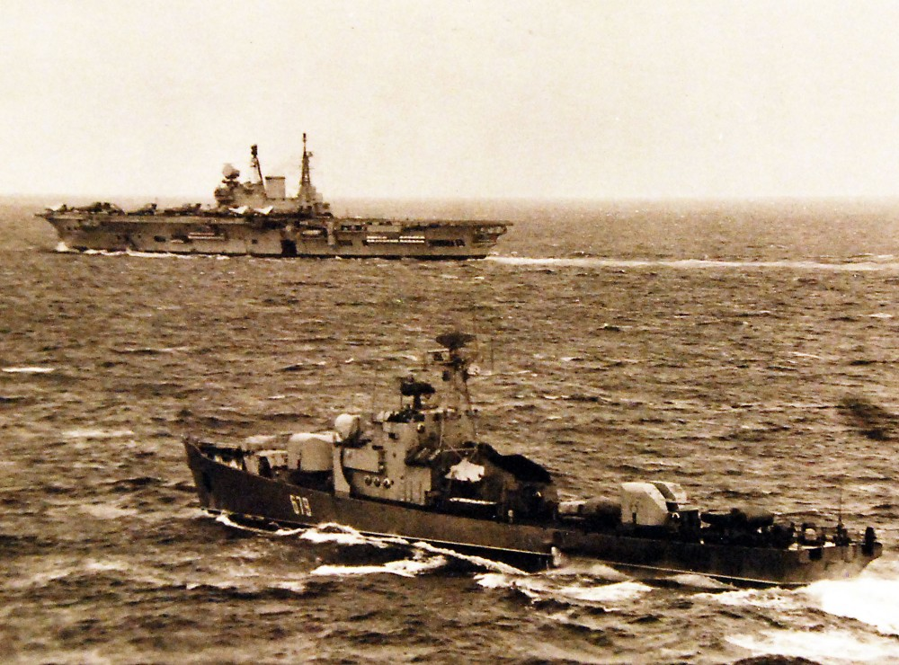 A Soviet Petya II Class Frigate, foreground, underway near the Royal Navy aircraft carrier Eagle, Number R 05. May 1975