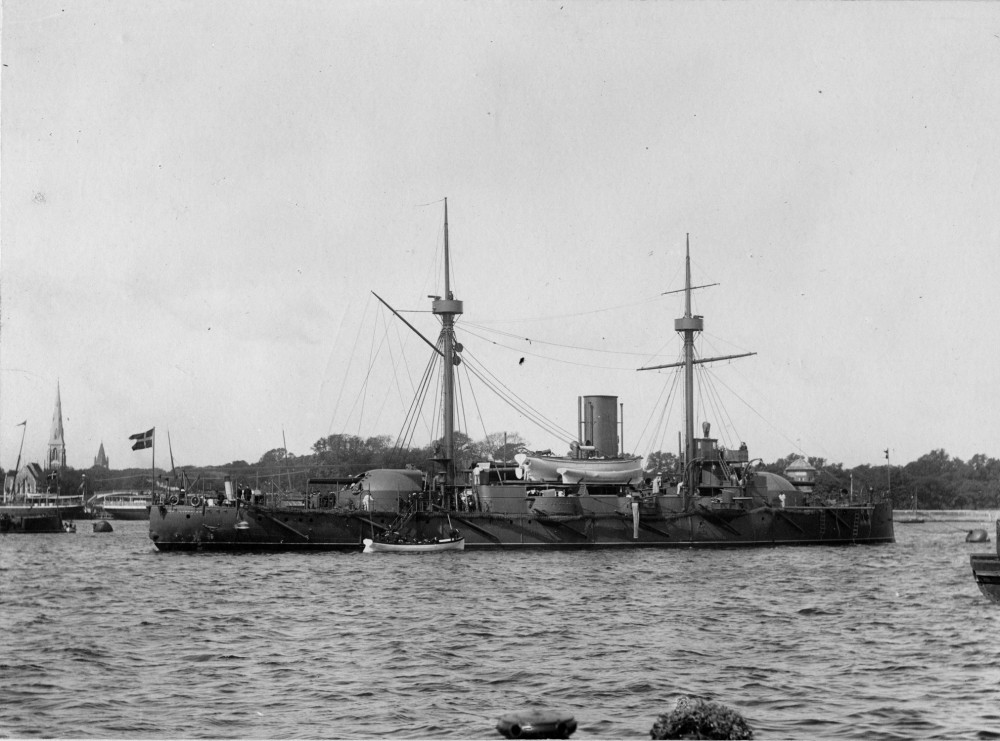 The armored ship Iver Hvitfeldt, (1887-1919). The ship is seen towards starboard, is moored at a buoy off Sondre Toldbod