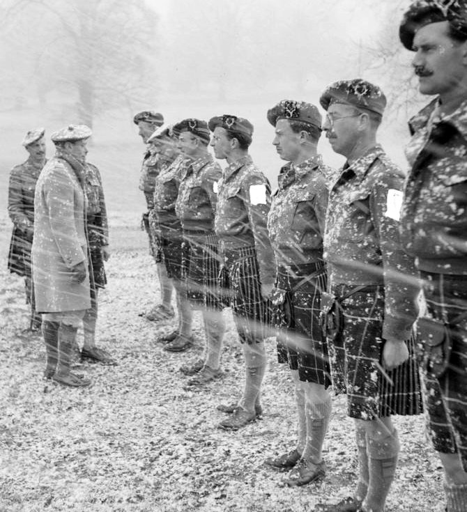 King George VI inspects officers of 5th Battalion, Seaforth Highlanders during a snow storm at Gorhambury Park in Hertfordshire, February 1944