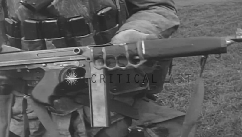 Pictured here is a trench knife attached to a Thompson Submachine gun