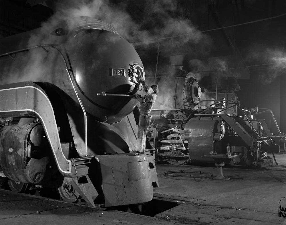 O. Winston Link (1914-2001) Polishing a train headlight, 1930s