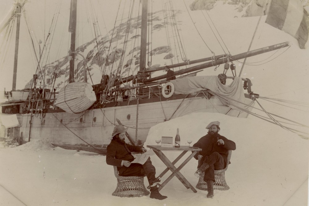 Ernest Gourdon (l) geologist and glaciologist, and Paul Pleneau (r) photographer, enjoy a glass of Mumm Champagne in Antarctica on Bastille Day 1904