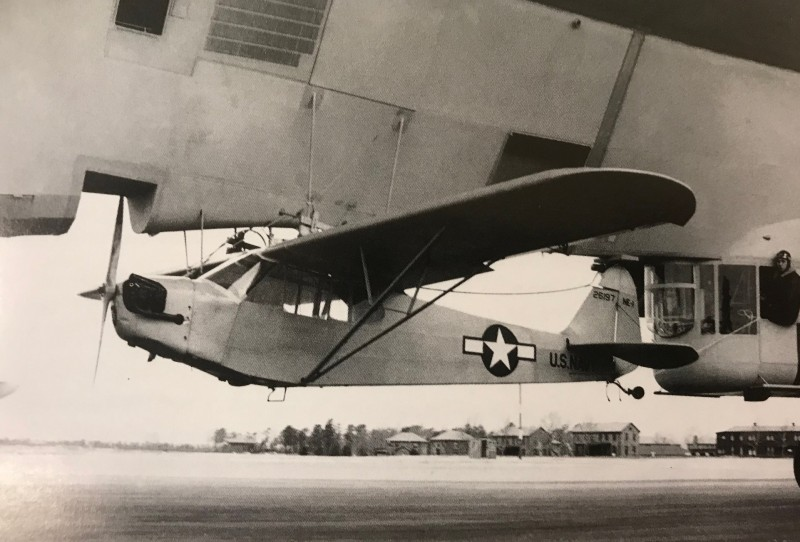 In 1944, concept in which a Piper NE-1 (J-3) Cub would be attached to an M-Class blimp and released mid-flight to carry out typical liaison duties. 'Glimpy' plans were also made to arm a RC version of the NE-1 with a depth charge