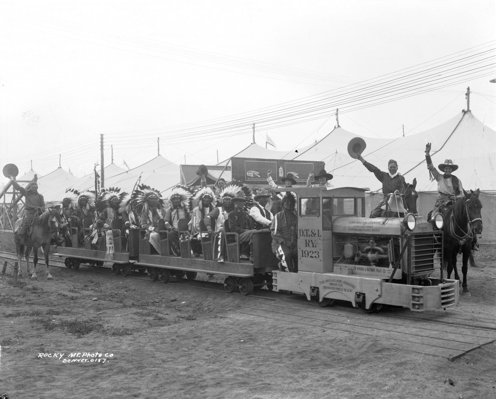 A group of Native Americans in small train probably at Overland Park in the Overland neighborhood in Denver, Colorado. [1923-1940]