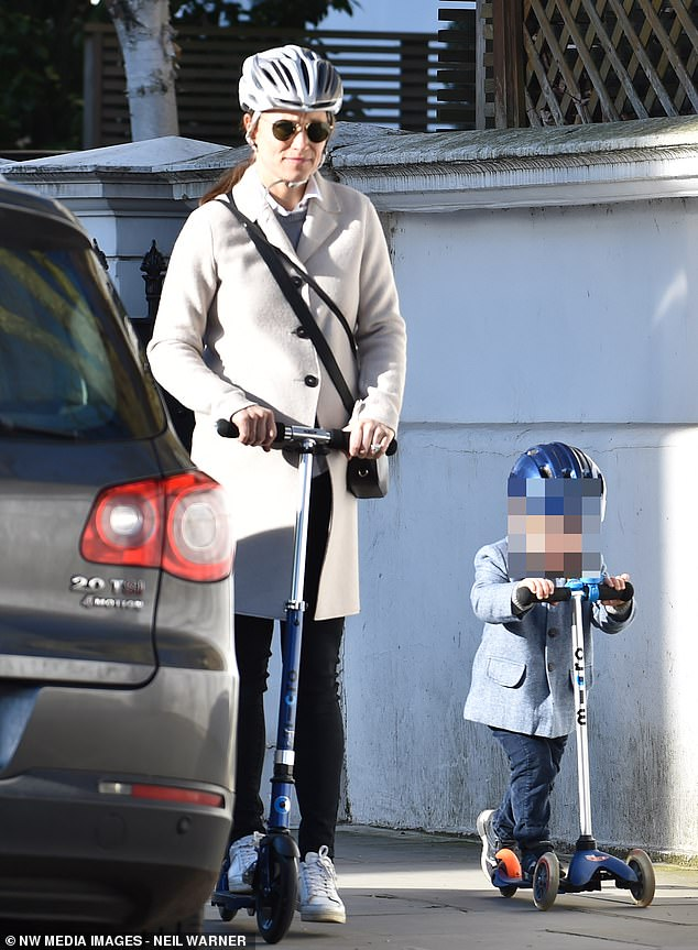 40288232-9345829-Pippa_Middleton_37_was_seen_riding_an_adult_scooter_with_her_two-a-22_1615370726597