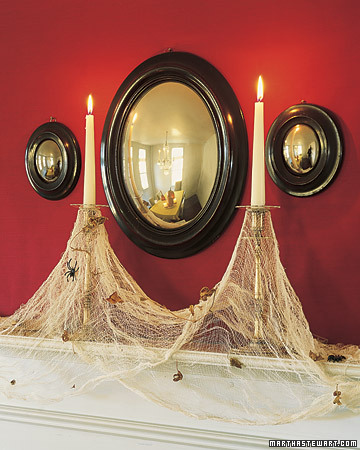 cheesecloth-spiderwebs-on-candles-halloween