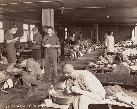 DachauTyphusWard American doctors care for sick prisoners in the Dachau typhus ward Typhus epidemic at Dachau