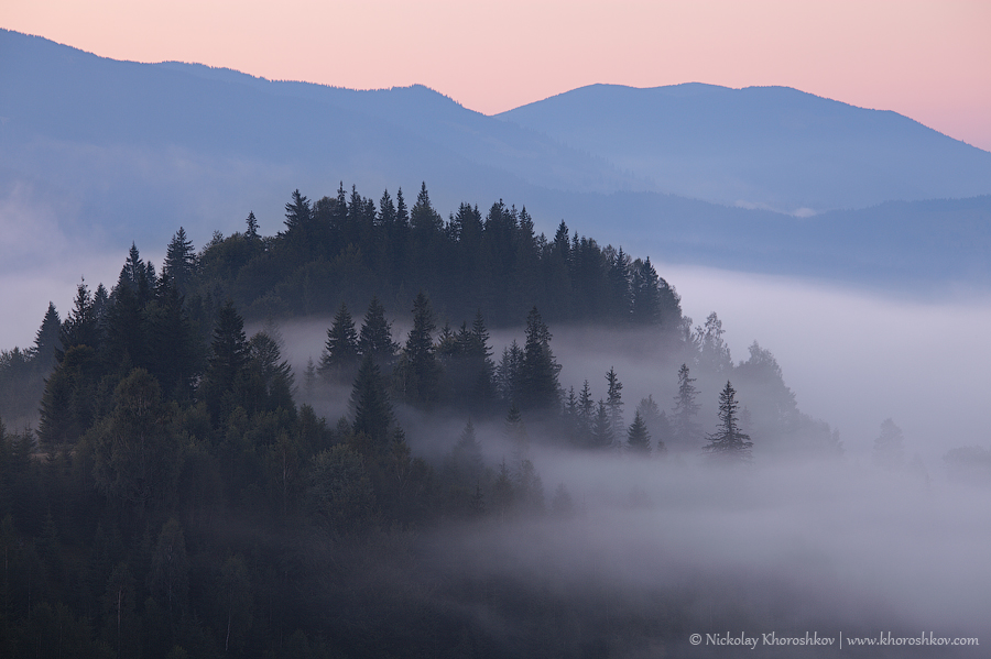 Foggy sunrise in Carpathian mountains