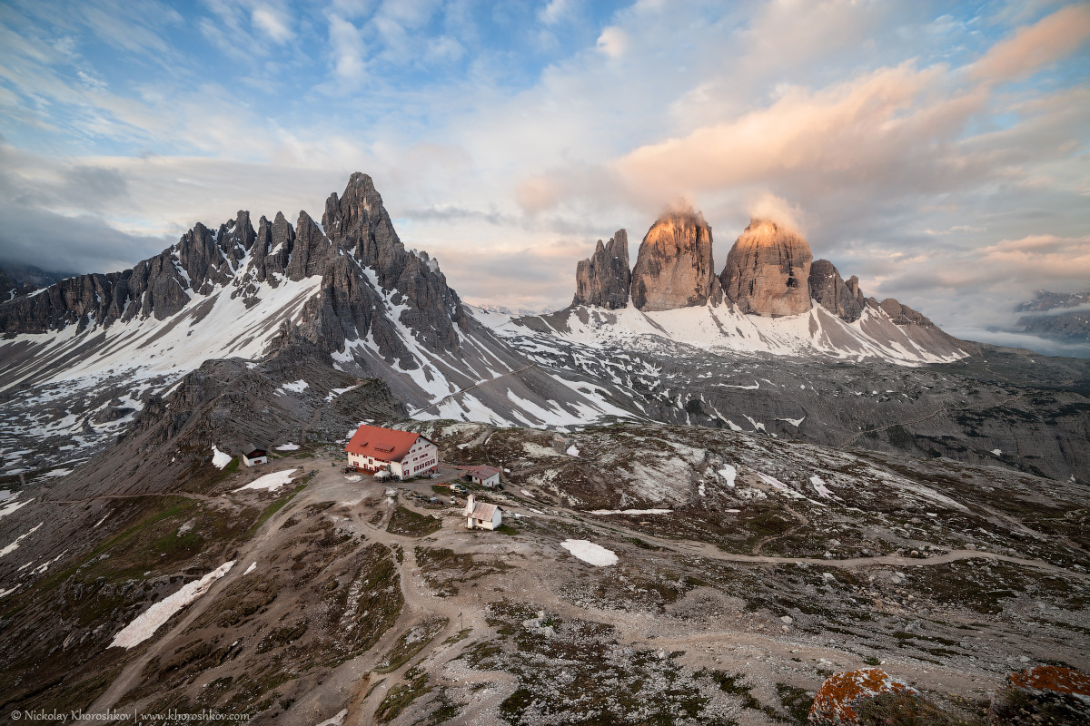 Panorama of Tre Cime and Monte Paterno at cloudy morning