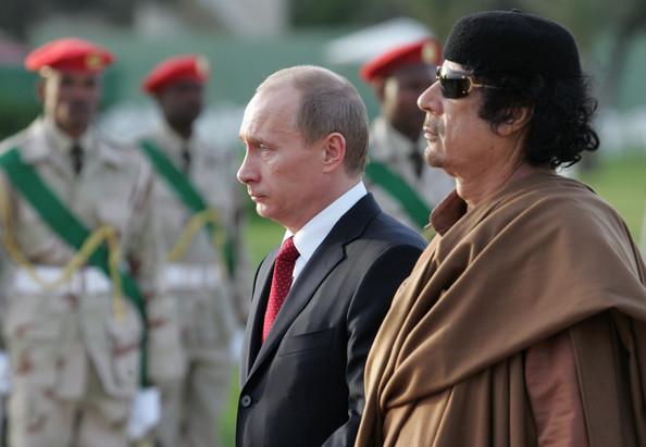 Владимир Путин и Муаммар Каддафи