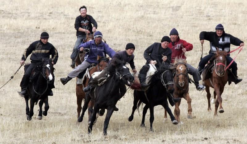 Mounted Kyrgyz men
