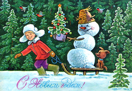 Мальчик везет на санках снеговика