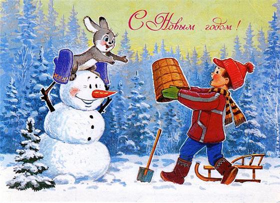 Мальчик и зайка лепят снеговика