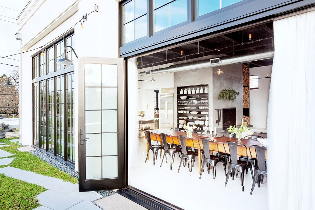 1_exterior-dining-room-view-windows-doors-portland-industrial-loft-cococozy-nyt