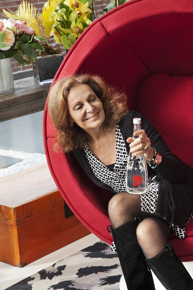 DVF looking at bottle