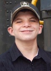 Photo of Jeffrey Franklin, a teenage boy wearing a baseball cap. His ears stick out and his skin is fair. He is smiling.
