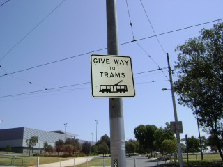 Pedestrian tram crossing sign, State Netball and Hockey Centre